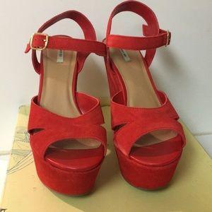 Red suede platform heels